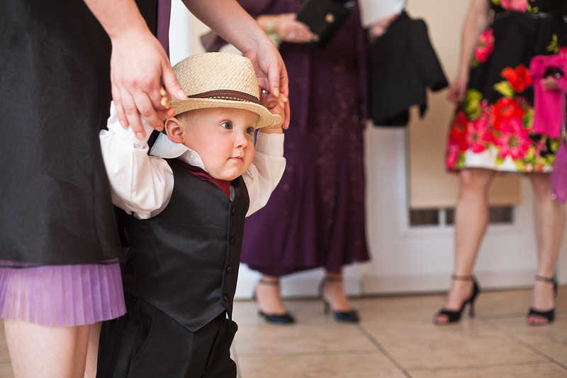 child in hat at wedding