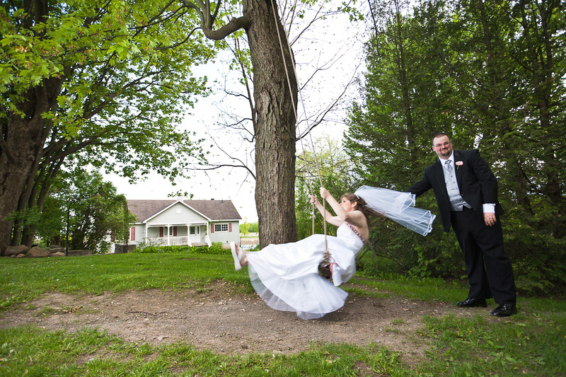groom pushing bride on swing - fun wedding photo