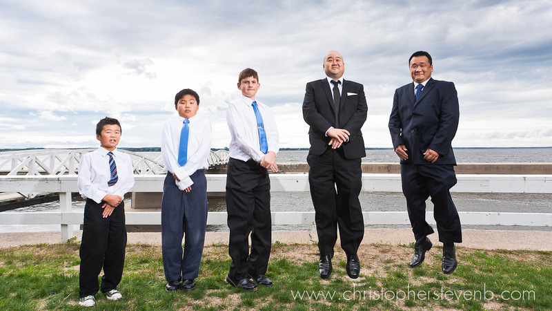 fun group photo of groomsmen levitating at the Britannia Yacht Club