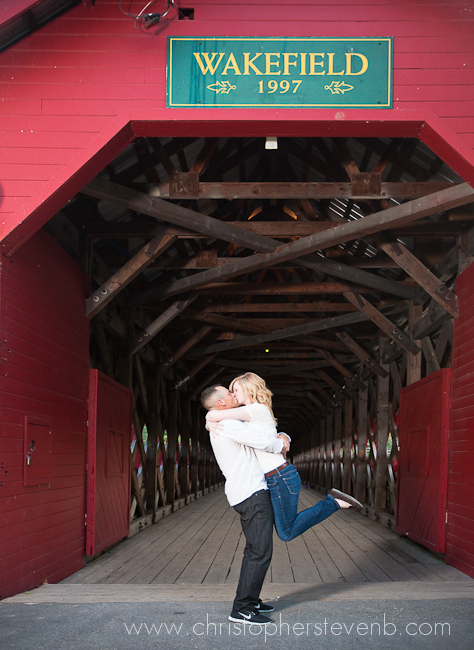 photo of couple hugging in front of Wakefield sign