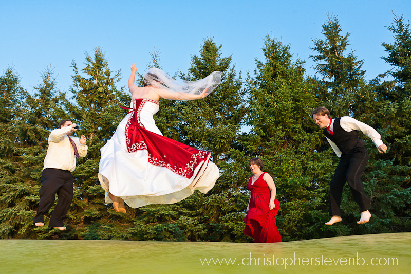 wedding party having fun jumping on trampoline