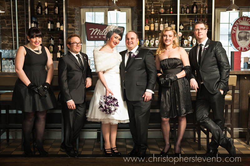 group photo of wedding party in lobby of Mill Street Brew Pub in Ottawa
