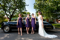 bride and her bridesmaids and antique car