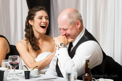 funny photo of bride hitting groom during wedding speech