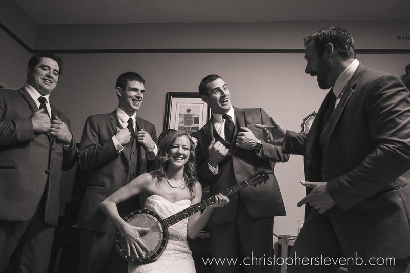 funny bridal party photo with bride playing banjo - rustic country wedding