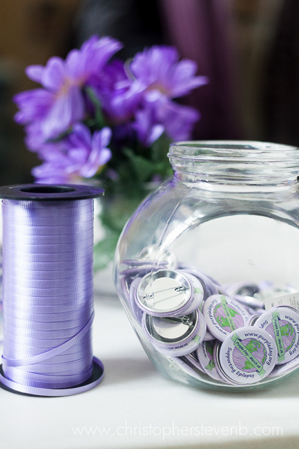 Buttons and ribbon for purple day
