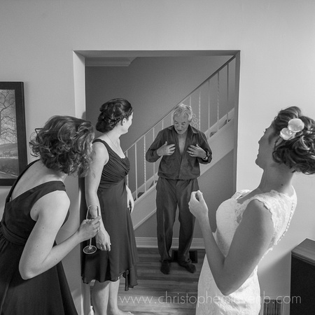 father of the bride making bridesmaids laugh